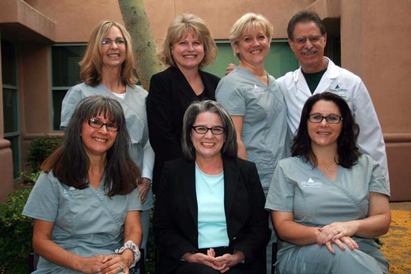 Dr. Davis and the smiling staff at The Arizona Institute for Periodontics & Dental Implants.
